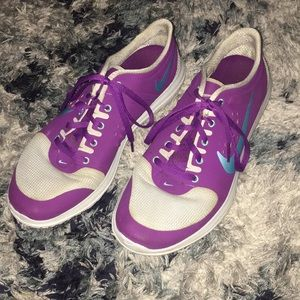 Purple, gray and teal Nike running shoes